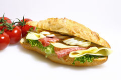 Baguette bun, salami, cheese, lettuce and boiled eggs Royalty Free Stock Images