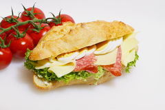 Baguette bun, salami, cheese, lettuce and boiled eggs Royalty Free Stock Image