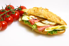 Baguette bun, salami, cheese, lettuce and boiled eggs Royalty Free Stock Photography