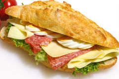 Baguette bun, salami, cheese, lettuce and boiled eggs Royalty Free Stock Photos