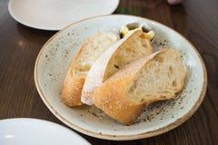 Baguette chleb z małym masło łękiem Zdjęcie Stock