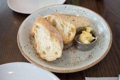 Baguette chleb z małym masło łękiem Obraz Royalty Free