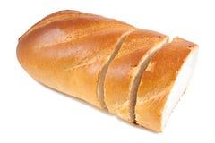 Baguette coupée en tranches de pain Images libres de droits