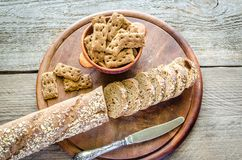 Baguette with crisps on the wooden tray Stock Images