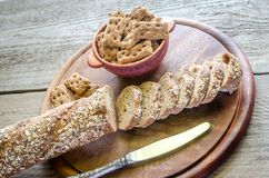 Baguette with crisps on the wooden tray Royalty Free Stock Photography