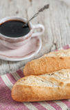 Baguette and cup of coffee on the wooden board Royalty Free Stock Photography