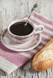 Baguette and cup of coffee on the wooden board Stock Photography