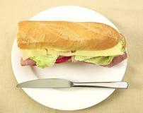 Baguette del jamón y del queso fotografía de archivo