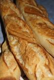 A baguette either simply baguette - Close-up. A baguette either simply baguette, so called baguette of Paris, or still French loaf, but also bread baguette is a Stock Photo