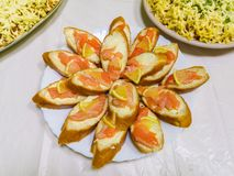 Baguette with fish and lemon, slices of salmon on slices of lemon royalty free stock photo