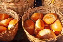 Baguette or French bread in the wicker baskets with morning light. Traditional food in Laos and Indochina. Laos Style. Pakse Mark. Et, Champasak Province, Laos stock image
