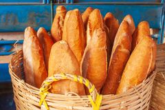 Baguette or French bread in the wicker baskets with morning light. Traditional food in Laos and Indochina. Laos Style. Pakse Mark. Et, Champasak Province, Laos royalty free stock images