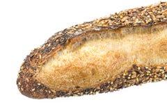 Baguette fresche con i semi su bianco un fondo Immagini Stock Libere da Diritti