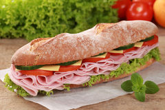 Baguette with ham stock images