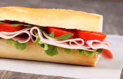 Baguette. With ham, cheese, lettuce and tomatoes royalty free stock photo