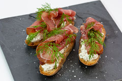 Baguette with ham and dill Stock Photos