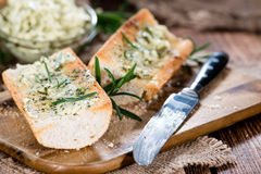 Baguette (with Herb Butter and Garlic). On rustic wooden background royalty free stock image