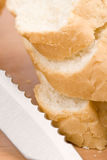 Baguette and knife Royalty Free Stock Photo