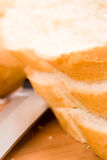 Baguette and knife Stock Images