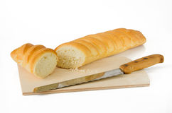Baguette with knife Royalty Free Stock Photo