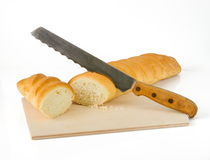 Baguette with knife Stock Photography