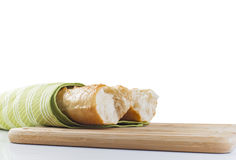 Baguette longo quebrado em partes no fundo branco Fotografia de Stock Royalty Free