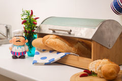 Baguette, lying in a breadbox Royalty Free Stock Photos