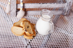 Baguette and milk in a jug on the table Stock Photos