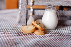 Baguette and milk in a jug on the table Royalty Free Stock Photography