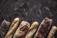 Baguette mix on a black background. French pastries, homemade. stock image