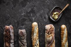 Baguette mix on a black background. French pastries, homemade. royalty free stock photography