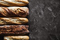 Baguette mix on a black background. French pastries, homemade. royalty free stock images