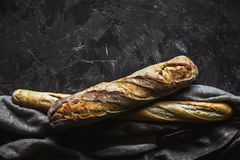 Baguette mix on a black background. French pastries, homemade. stock images
