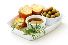 Baguette and olive oil Stock Photos