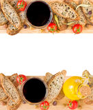 Baguette, olives, olive oil, vine, peppers and tomatoes, copy space. Stock Images