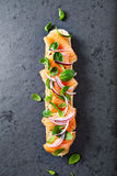 Baguette with organic smoked salmon topped with herbs Royalty Free Stock Photos
