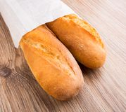 Baguette in paper bag Stock Photos