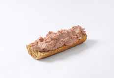 Baguette with pate. Fresh baguette with pate on white background Stock Images