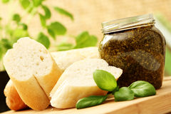 Baguette and pesto Stock Photo