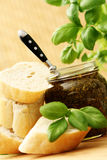 Baguette and pesto. Baguette and jar of pesto - delicious snack - food and drink Royalty Free Stock Images