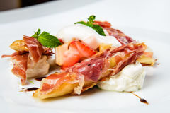 Baguette pieces covered with grilled bacon on plate served luxury. Royalty Free Stock Photo