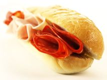 Baguette with salami, close-up Stock Photography