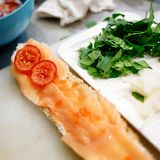 Baguette with salmon in the cooking process royalty free stock image