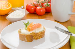 Baguette with salmon on a table Stock Photography