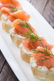 Baguette with Salmon on wood Stock Photography