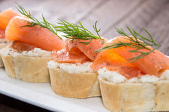 Baguette with Salmon on wood Royalty Free Stock Photography