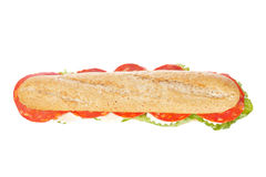 Baguette sandwich. A baguette sandwich with spanish chorizo, lettuce, tomatoes and cheese. Shallow depth of field stock photography