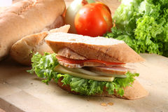 Baguette sandwich. Sandwich stuff with vegetable, cheese, onion, ham & tomato and some ingredients as background stock images