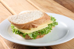 Baguette sandwich. Sandwich stuff with vegetable and cheese on plate royalty free stock images