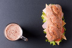 Baguette sandwich with a cappuccino royalty free stock photos